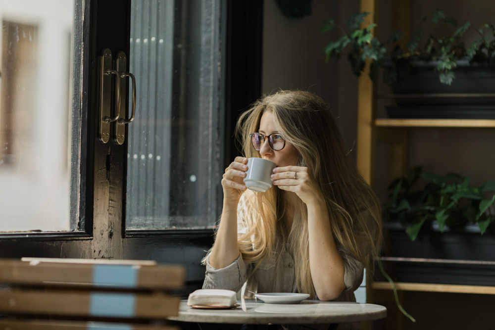 Woman in classic coffee bar
