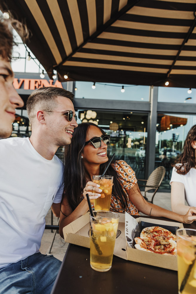 young friends dining on the terrace of the Viena restaurant