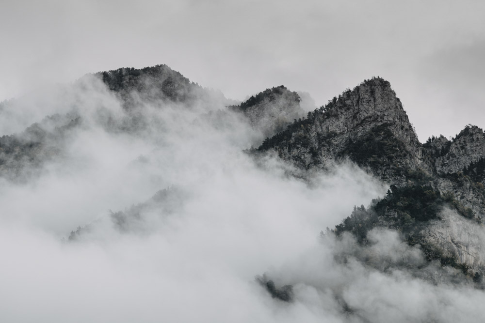 Landscape picture of peaks surrounded by mist